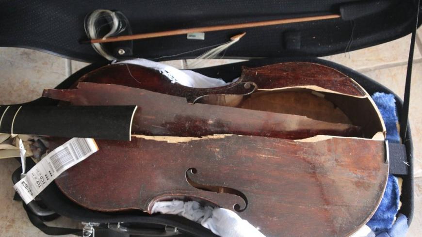 翻攝/Myrna Herzog臉書 17世紀古提琴搭機託運 下機後竟「像被車輾過」