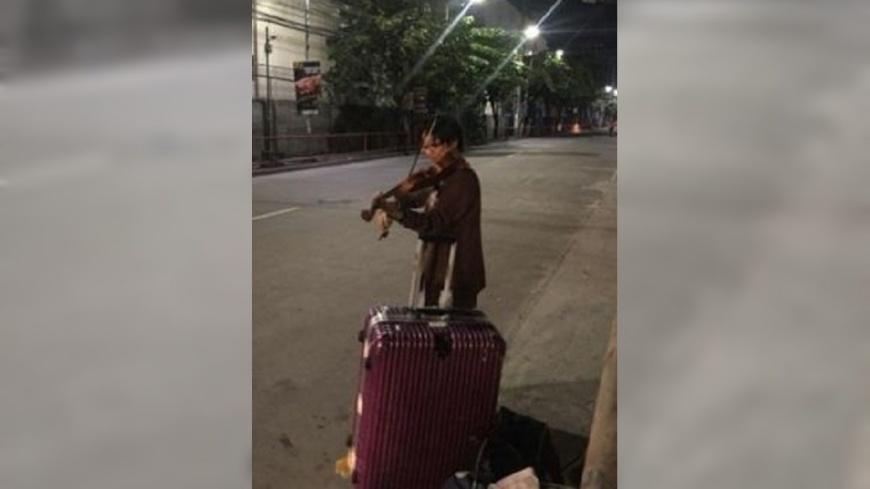 圖/翻攝自 Shaina Sofia 臉書 街頭拉小提琴賺盤纏 台女旅菲被誤認成街友
