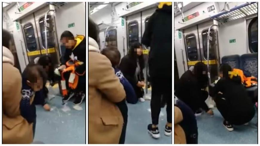 小嬰兒在火車上吐奶,一名女乘客主動幫忙跪地擦拭,讓網友大讚溫暖。(圖/翻攝自YouTube) 最美風景!小嬰兒搭火車吐奶 女孩跪地幫擦拭地板