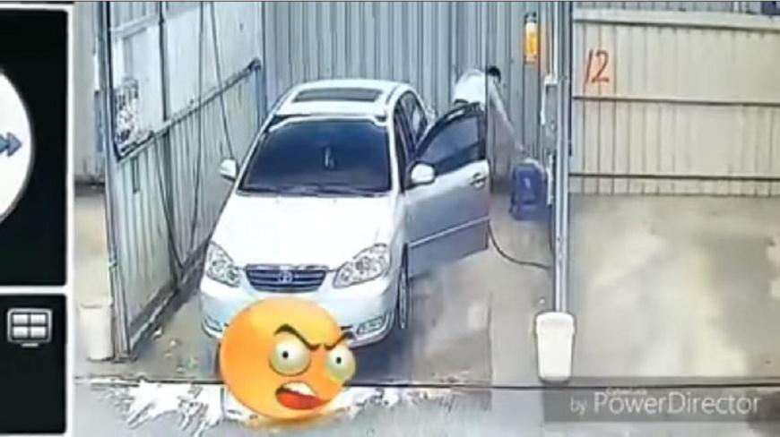 有男子到洗車場不洗車,反而是拿自家垃圾來丟,而且還不只一次。(圖/翻攝自YouTube) 扯!男到洗車場不洗車 拿出自家垃圾狂丟