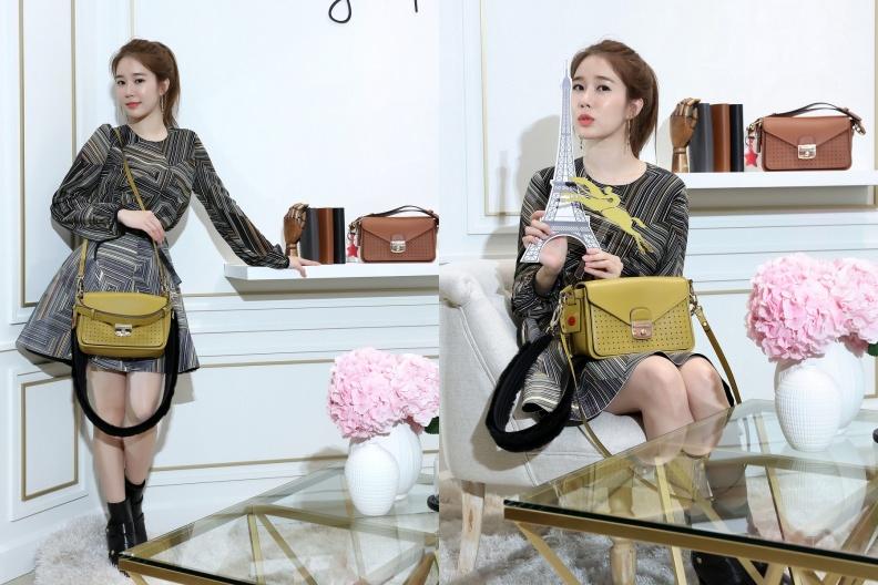 1.劉仁娜以一襲印花俏麗裙裝,搭配含羞草黃色Mademoiselle Longchamp包款現身,演繹都會時髦的法式時尚態度。-1.jpg