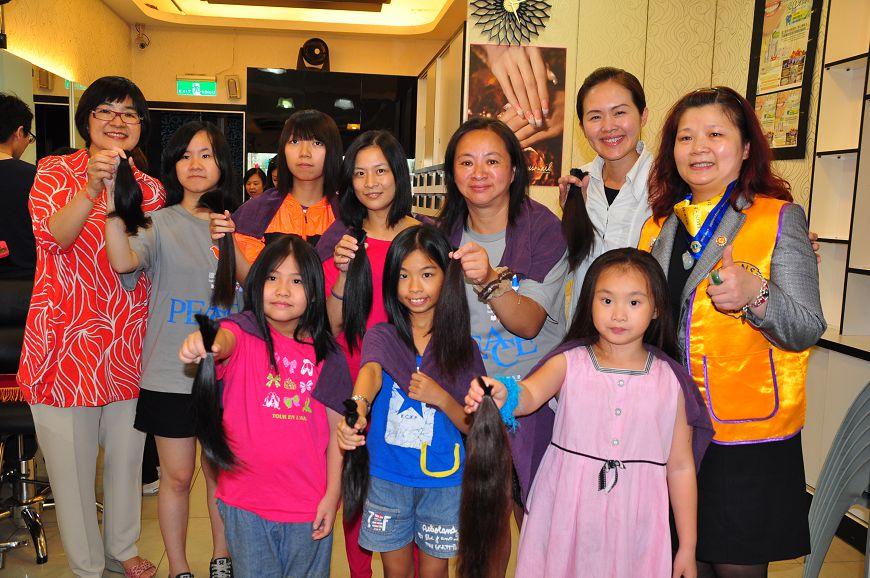 圖/新北市政府 不捨癌童化療掉髮 7歲女童剪百公分秀髮樂捐