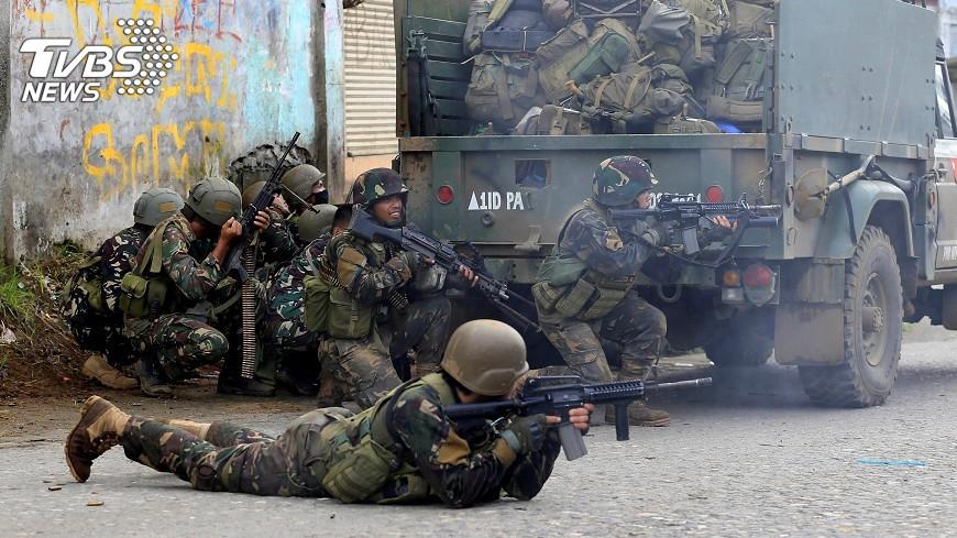 圖/達志影像路透社 菲政府軍與好戰分子激戰 雙方46人喪生