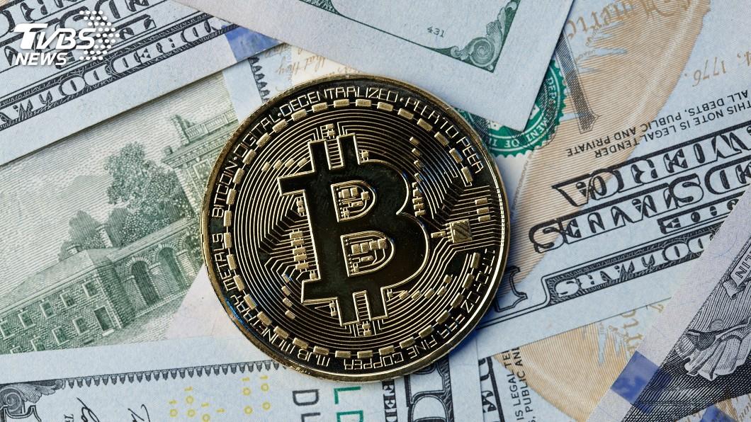 加密貨幣比特幣交易價格衝破5萬美元。(示意圖/shutterstock 達志影像) 比特幣創新天價 3檔挖礦概念股飆漲停