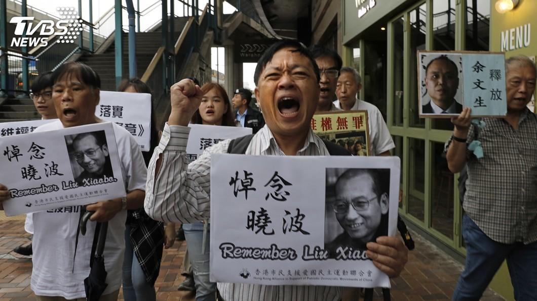 圖/達志影像美聯社 紀念劉曉波逝世一週年 港支持者遊行