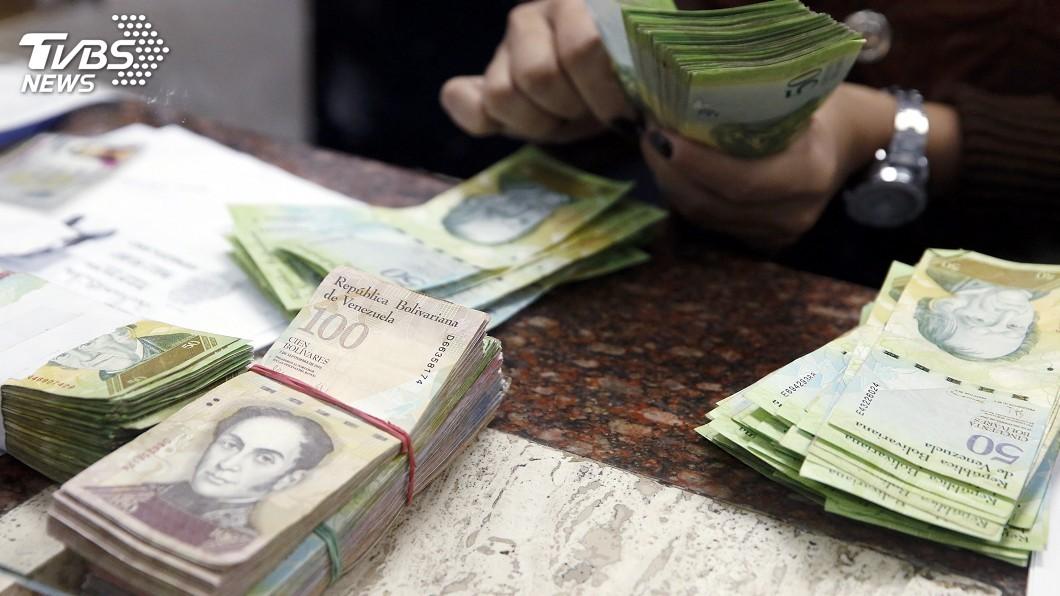 圖/達志影像路透社 IMF示警 委國年通膨率將飆至百分之1百萬