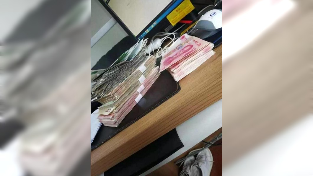 浙江日前發生一起竊案,2名竊賊主動投案並歸還款項,他們聲稱「錢太多了」而良心不安。(圖/翻攝自騰訊網) 破車窗偷錢隔天自首 2竊賊:錢太多花到會怕