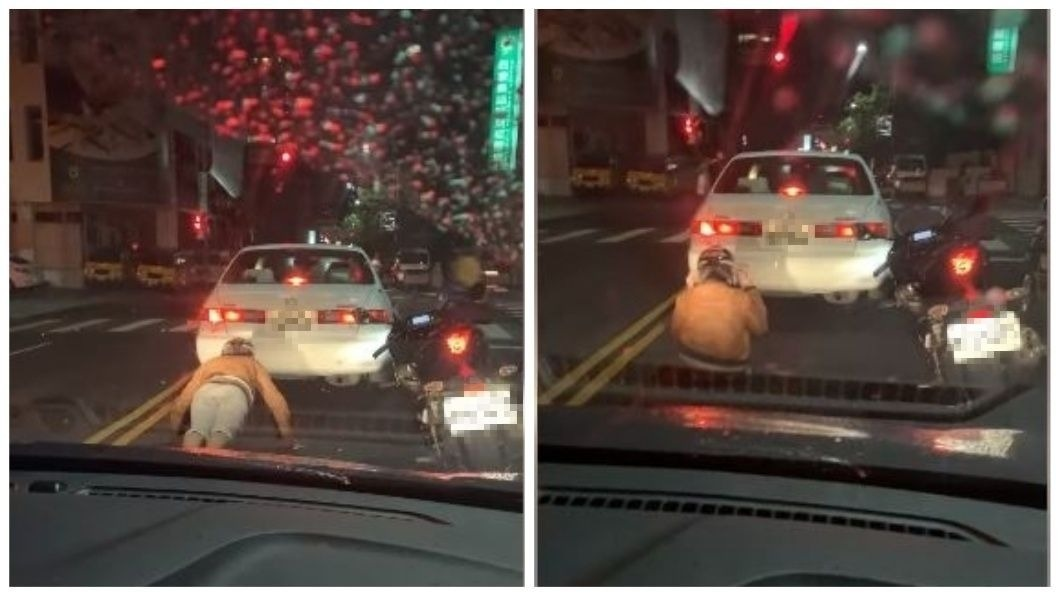 日前在一處路口紅燈時,有機車騎士在馬路上做伏地挺身和仰臥起坐。(圖/翻攝自爆料公社) 利用時間?停等紅燈空檔 騎士連做伏地挺身仰臥起坐健身