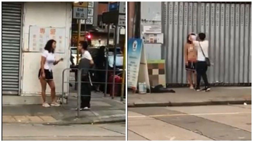 日前香港街頭一對情侶當街大吵,女生竟然在大庭廣眾下脫掉上衣和解開褲頭。(圖/翻攝自YouTube) 懷疑情郎劈腿…情侶當街大吵 女當街脫衣解熱褲