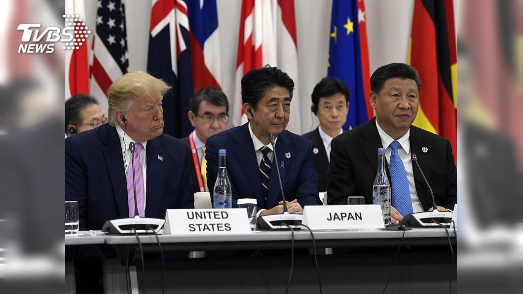 圖/達志影像美聯社 川習成G20焦點 習近平特別走向川普握手致意