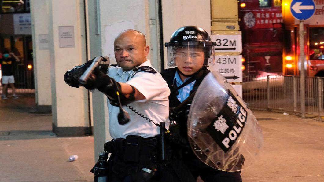圖/達志影像路透 中聯辦衝突44人起訴暴動罪 今開庭.千人法院聲援
