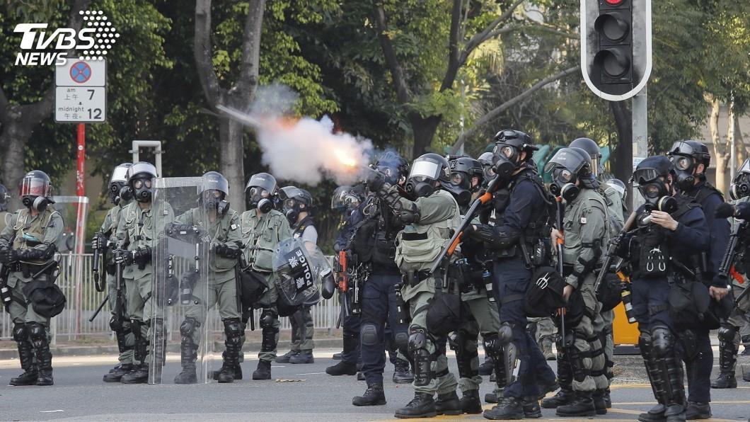 圖/達志影像美聯社 港警實彈射中反送中示威學生 並控傷者暴動罪