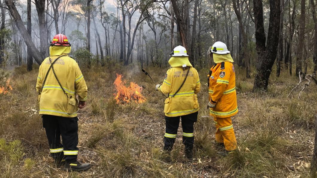 圖/達志影像路透 澳洲義消火場過耶誕 民眾感恩備禮送暖