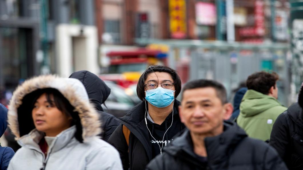 圖/達志影像路透 「出自武漢的肺炎」全球擴散 歐美亞裔遭殃