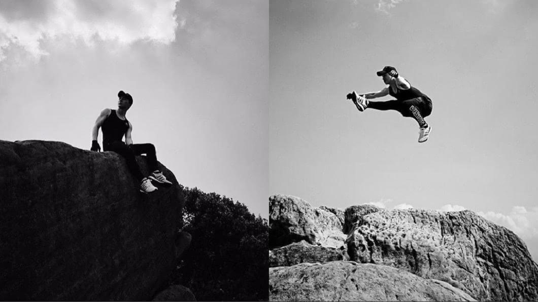 張洛偍到內湖登山做出高難度飛躍式跳躍。(圖/翻攝自張洛偍臉書) 罹腦膜炎暴瘦9KG!男星停工1年「懸石上一跳」網嚇壞