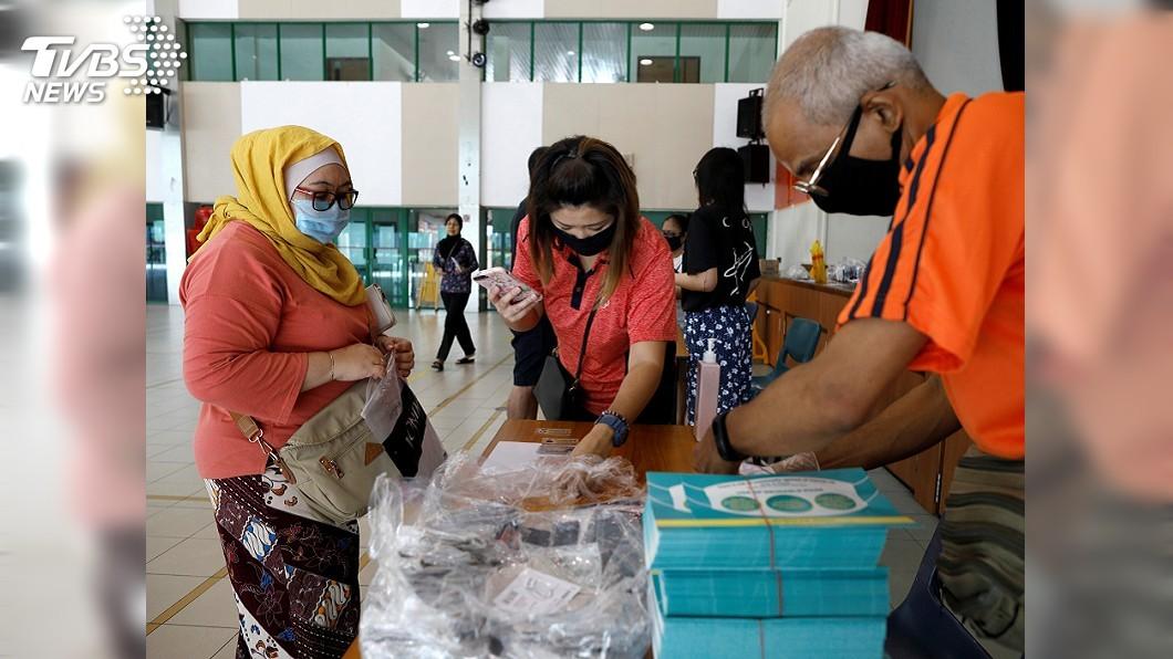 圖/達志影像路透社 新加坡將再配發口罩給民眾 為恢復經濟做準備