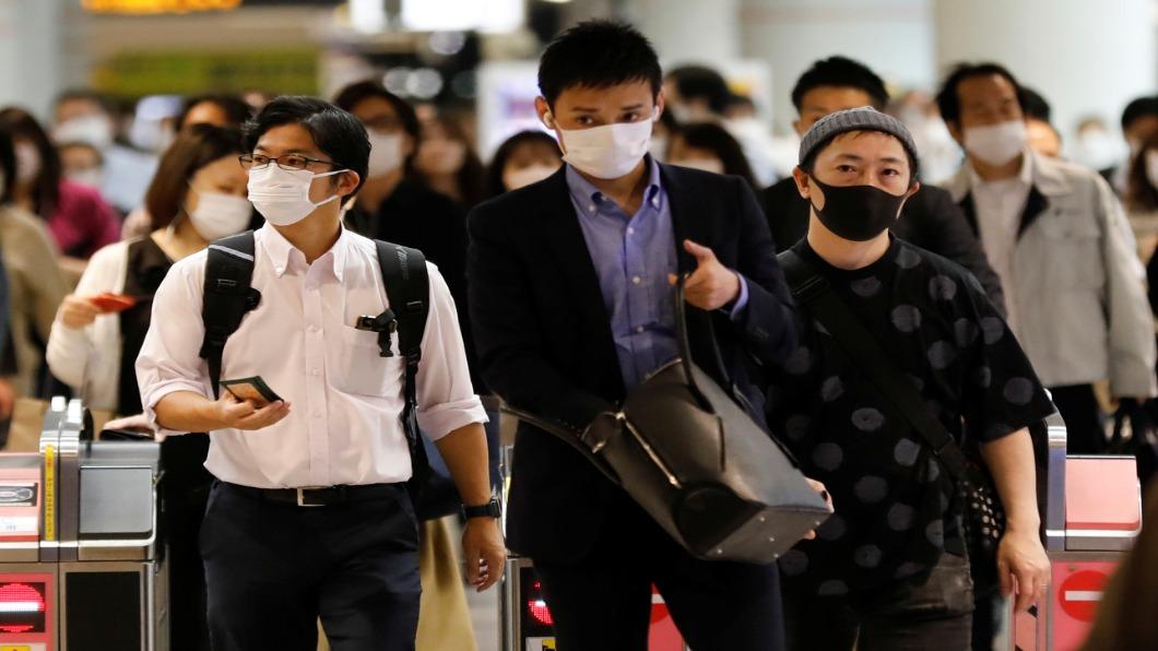 圖/達志影像路透 日本猛暑蓄勢待發 口罩難戴.病毒難防