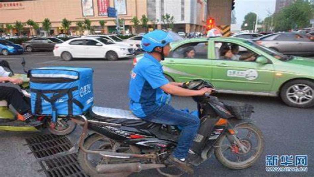 圖/翻攝自 新華網 北京爆外賣員確診 每日接50單.送餐範圍廣