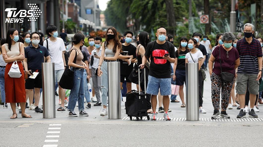 新加坡近來社區病例略為上升。(圖/達志影像路透社) 星解封後社區病例升 專家憂不守社交距離成風險