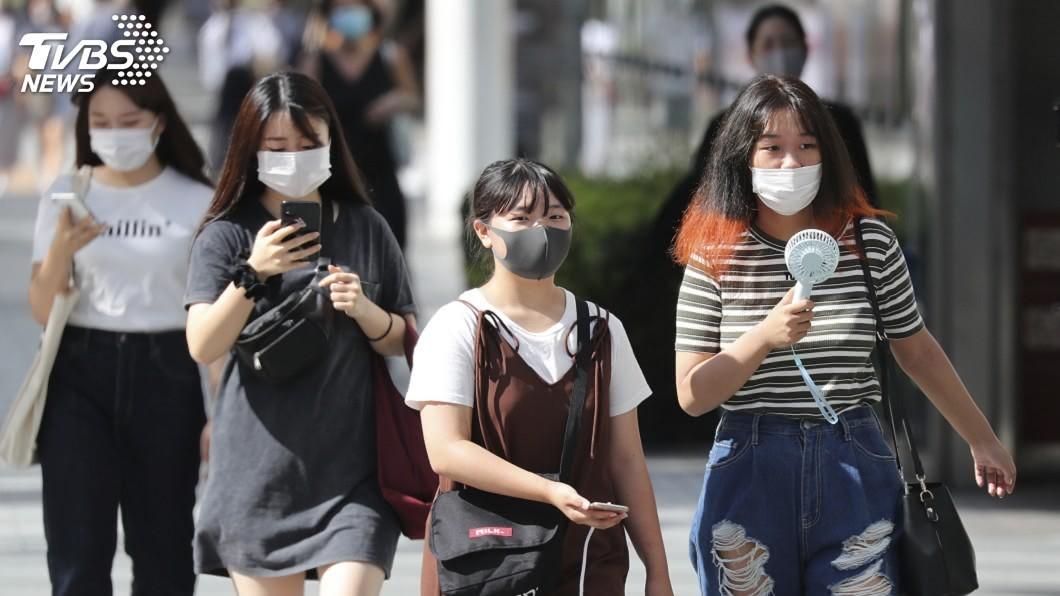 日本新增699例武漢肺炎確診。(圖/達志影像美聯社) 日本確診武漢肺炎逾5萬例 短短8日內新增1萬人