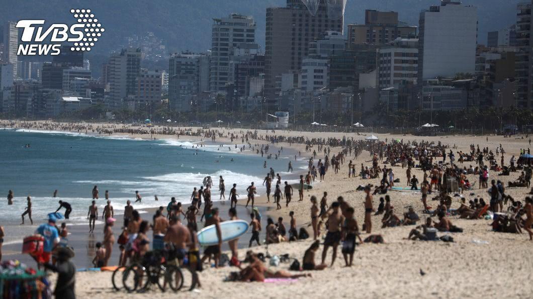(圖/達志影像路透社) 去海灘先用手機App劃位? 里約提案民眾不領情