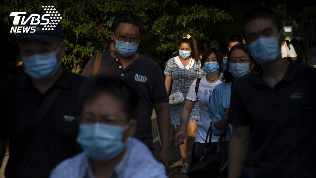 大陸官方公布新增11名新冠肺炎境外移入。(圖/達志影像美聯社) 陸新增11例新冠肺炎確診 皆境外移入