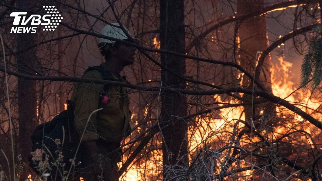 美國華盛頓州野火延燒造成空氣品質比北京和上海糟。(圖/達志影像路透社) 空氣比北京、上海糟 西雅圖煙塵瀰漫不見天日