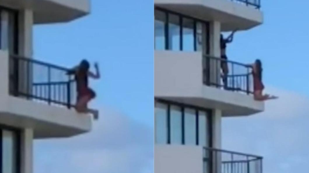 女子懸掛在11樓陽台外。(圖/翻攝自推特) 玩命掛11樓高空自拍 女僅「雙手撐」差點變亡美