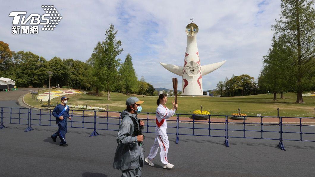 (圖/達志影像美聯社) 東奧聖火傳遞到大阪 為防疫全程不開放一般觀眾