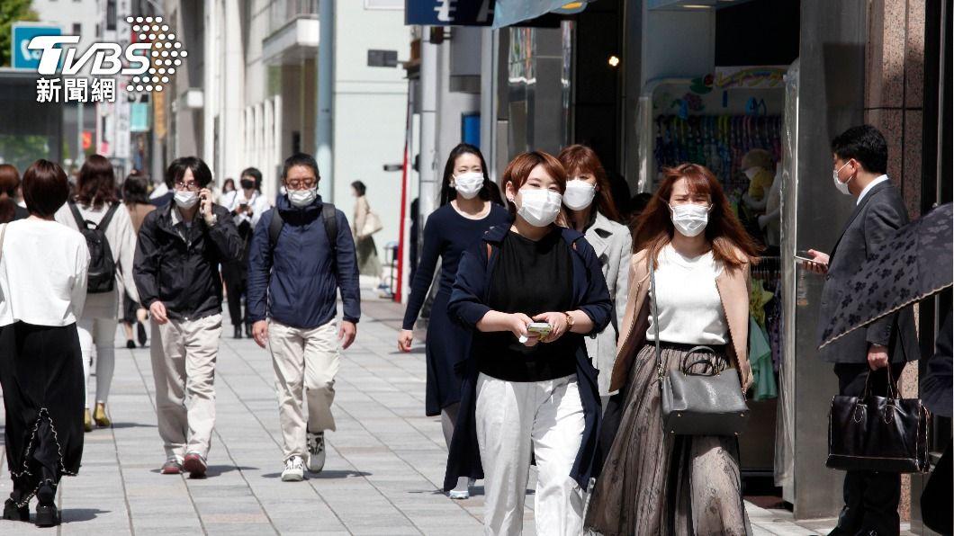 (圖/達志影像美聯社) 盼民眾做好防疫措施 日本:打疫苗後仍應戴口罩