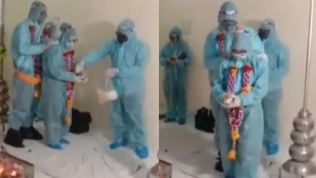 印度一對新人身穿隔離衣舉辦婚禮。(圖/翻攝自@ANI推特) 印新郎確診7天 「全套隔離衣」硬辦婚禮挨轟:有多急