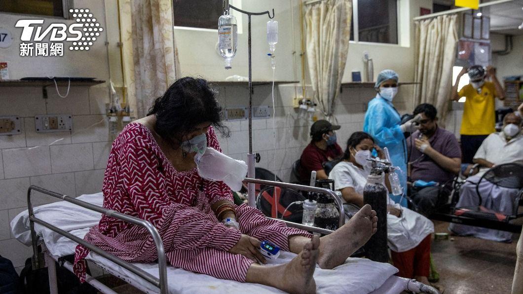 印度第2波疫情嚴峻。(圖/達志影像路透社) 全球確診破1.5億大關 印度首位台幹染疫亡