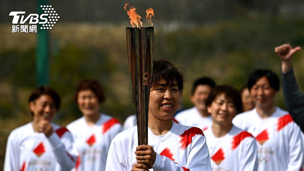 日本奧聖火傳遞。(圖/達志影像路透社) 日本東京奧運聖火傳遞 驚傳司機確診