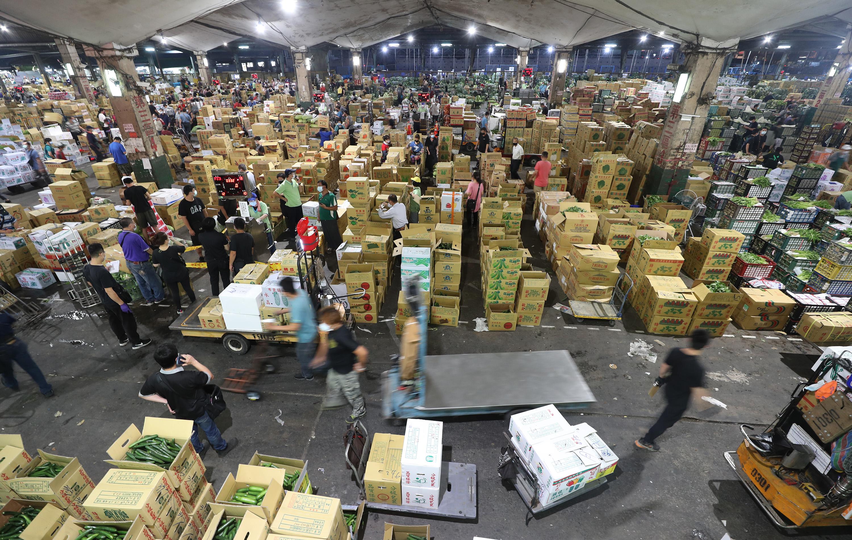 圖/中央社 北農:全聯蔬果從產地包裝 營業部員工再篩檢