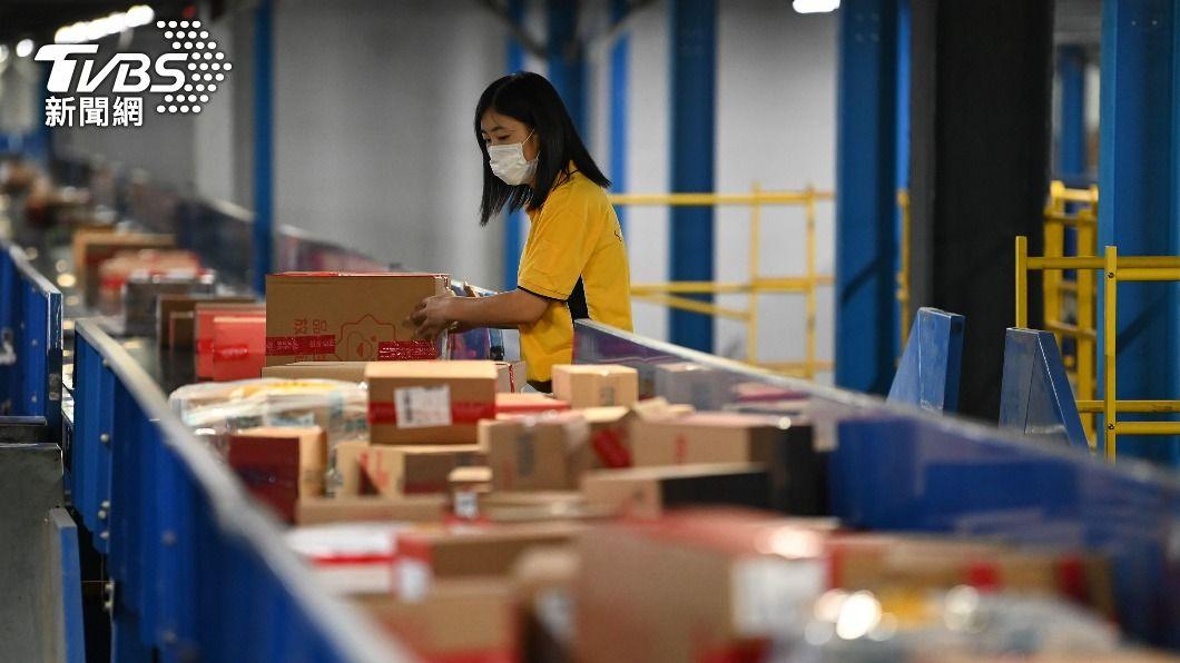 618購物節成為大陸電商的指標戰場。(圖/中央社) 618「含新量」高業績成長 陸電商鼓吹消費引爭議