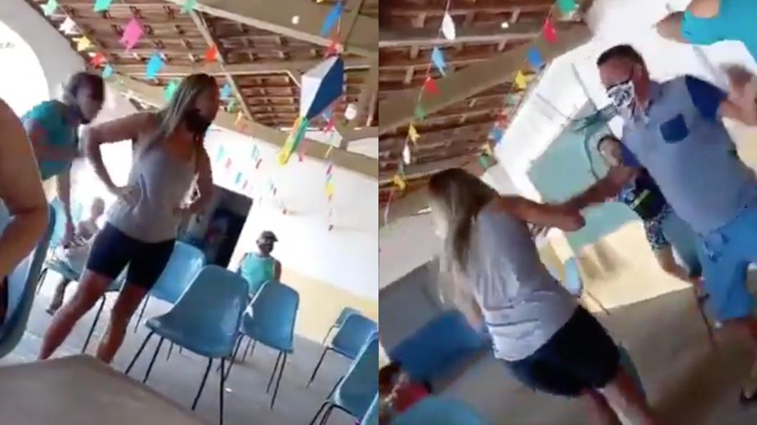 巴西一處接種站日前上演3女1男大亂鬥。(圖/翻攝自推特) 帶小三打疫苗遇老婆!巴西接種站「3女1男亂鬥」畫面曝