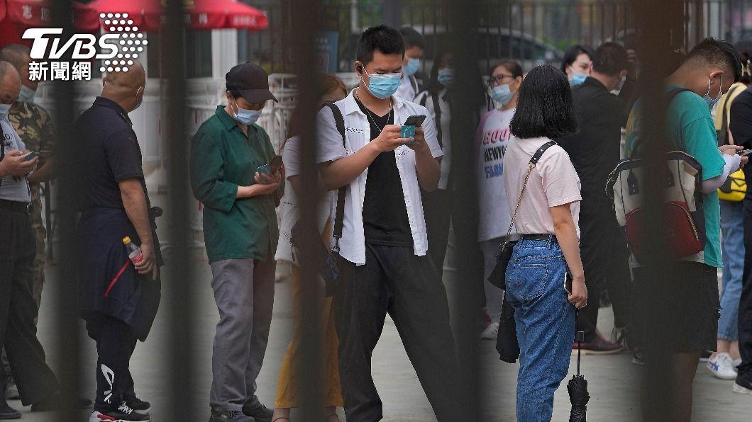陸本土疫情擴散。(圖/達志影像美聯社) 大陸本土疫情持續多省擴散 55確診44無症狀