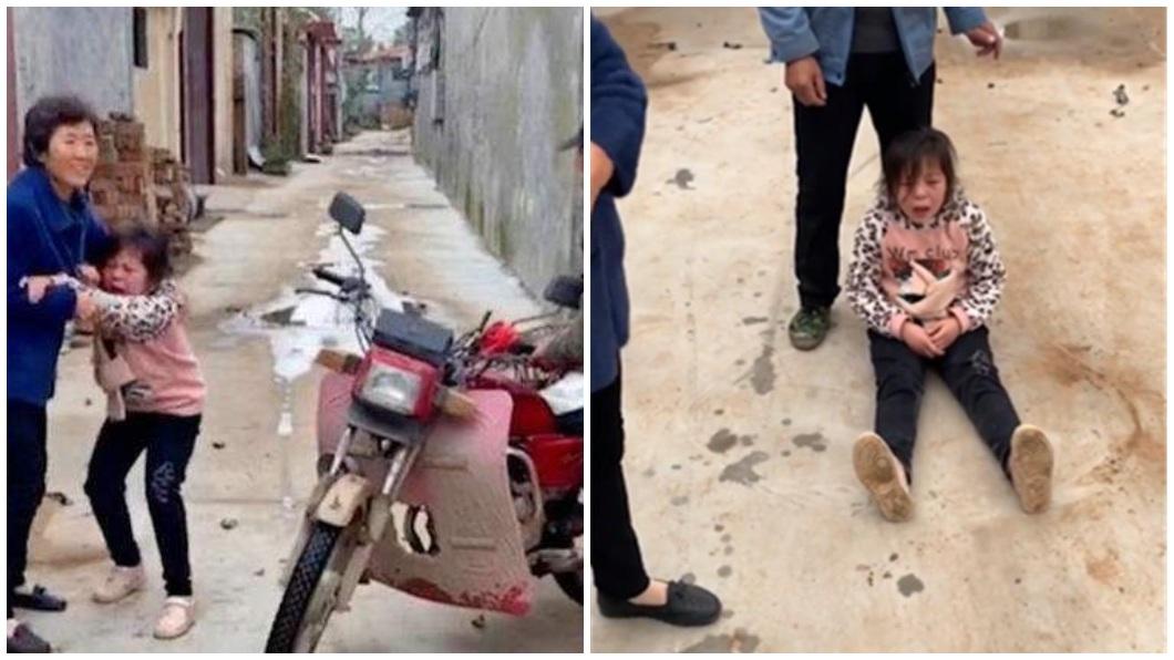 河南一名阿嬤將家中飼養犬隻賣給狗販,孫女當場坐地痛哭。(圖/翻攝自搜狐新聞) 陸阿嬤44元賣了寵物犬 孫女坐地崩潰哭喊「不要」
